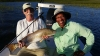 Bill and jim tailing red fish