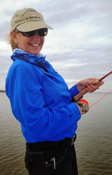 Julie leanin\' on a red fish